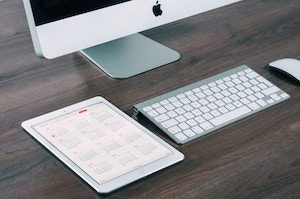 Scheduler and computer on desk